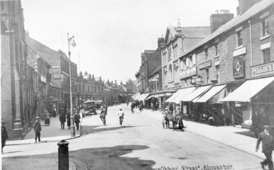 Pedestrians, bicycles, pony and trap in Abbey Street, Nuneaton.  1930s |  IMAGE LOCATION: (Warwickshire Museums. Photographic Collections.)