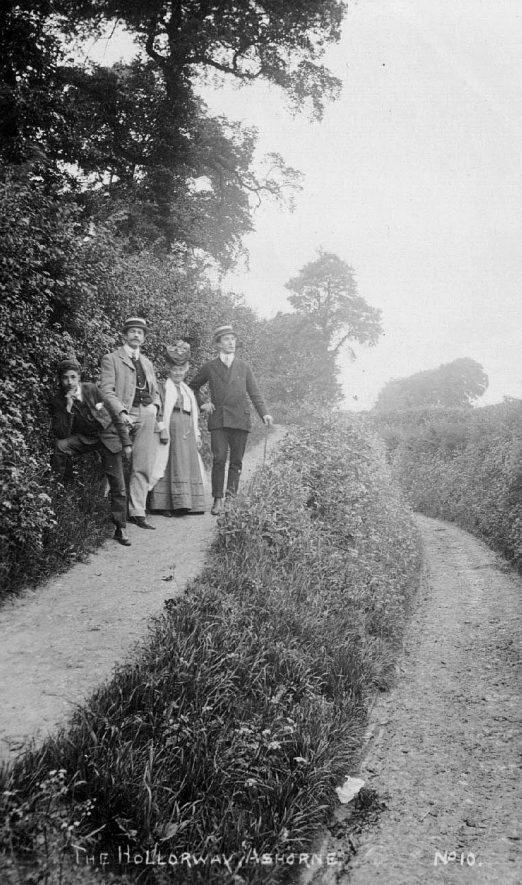 The Holloway, Ashorne, with group of people in their best clothes.  1900s |  IMAGE LOCATION: (Warwickshire County Record Office)