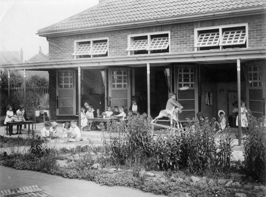 Children playing on the veranda at Hartshill Infants school.  1941 |  IMAGE LOCATION: (Warwickshire County Record Office)