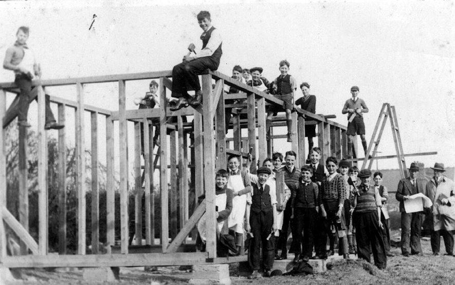 Hartshill North C. schoolboys at work building a new pavilion for the playing fields.  1930s |  IMAGE LOCATION: (Warwickshire County Record Office)