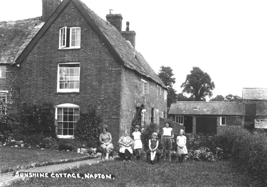 A family group outside Sunshine Cottage, Napton on the Hill.  1930s |  IMAGE LOCATION: (Warwickshire County Record Office)