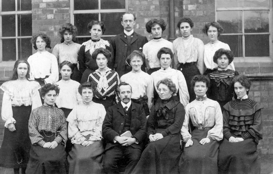 Group of teachers and staff at Abbey Street School, Nuneaton.  Postmarked 1905 |  IMAGE LOCATION: (Warwickshire County Record Office)
