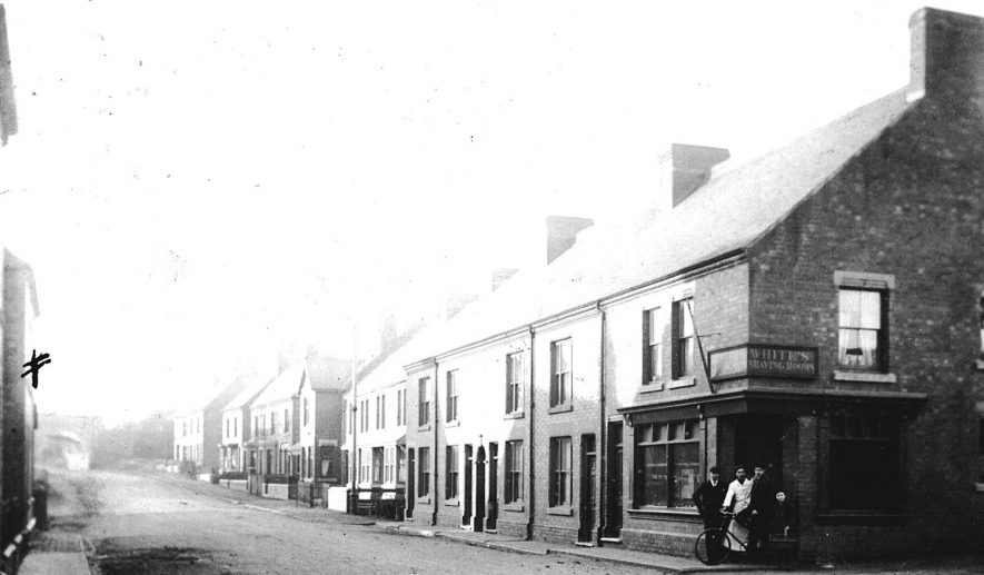 Ansley Road, Chapel End, Nuneaton.  1900s  Barber's on the corner of the street: 'White's Shaving Rooms'. |  IMAGE LOCATION: (Warwickshire County Record Office)