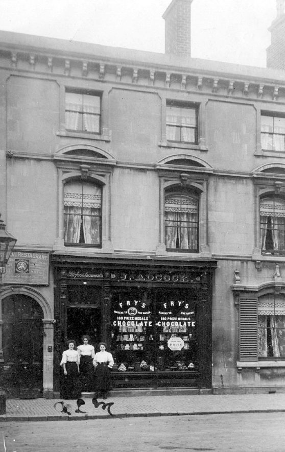 Shop and restaurant  belonging to J. Adcock, Long Street,  Atherstone, with three waitresses standing outside.  Early 1900s |  IMAGE LOCATION: (Warwickshire County Record Office)