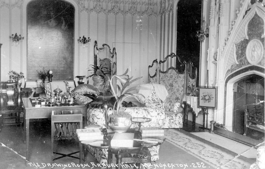 Furniture and furnishings in the drawing room at Arbury Hall, near Nuneaton.  1900s |  IMAGE LOCATION: (Warwickshire County Record Office)