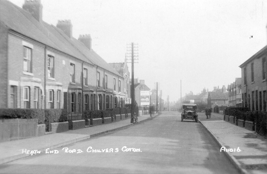 Terraced houses and motor car in Heath End Road, Chilvers Coton.  1930s |  IMAGE LOCATION: (Warwickshire County Record Office)