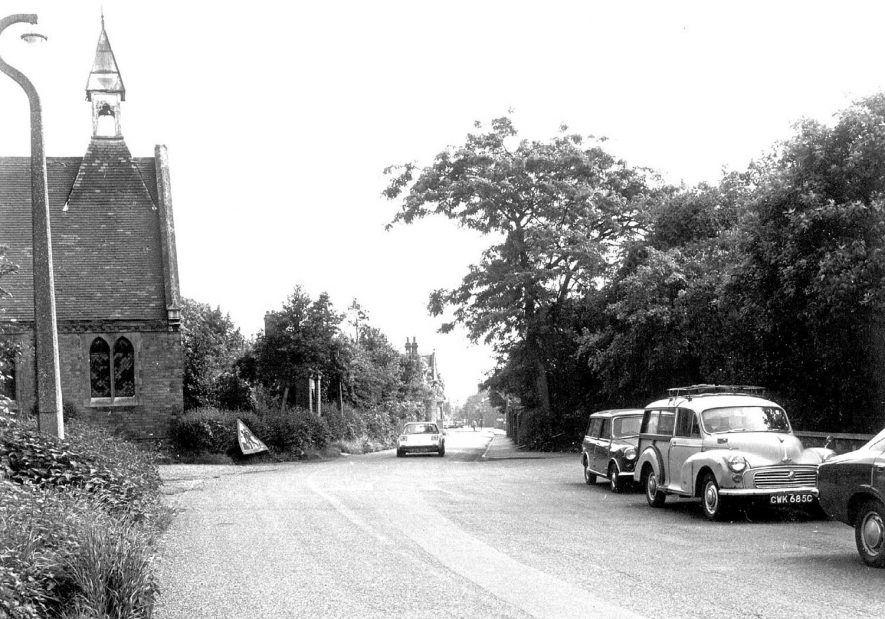 Lakin Road, Warwick, with hospital chapel on the left (now demolished).  1960s   IMAGE LOCATION: (Warwickshire County Record Office)