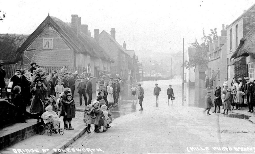 Large group of children looking at flooding in Bridge Street, Polesworth.  1910s |  IMAGE LOCATION: (Warwickshire County Record Office)