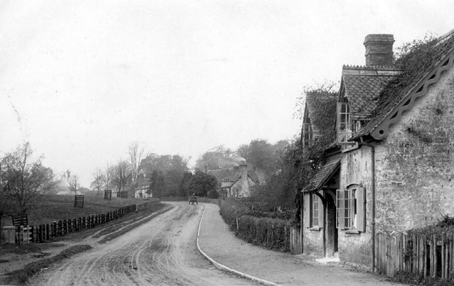 Village scene in Arrow showing the edge of Ragley Park on the left of the picture.  1904 |  IMAGE LOCATION: (Warwickshire County Record Office)