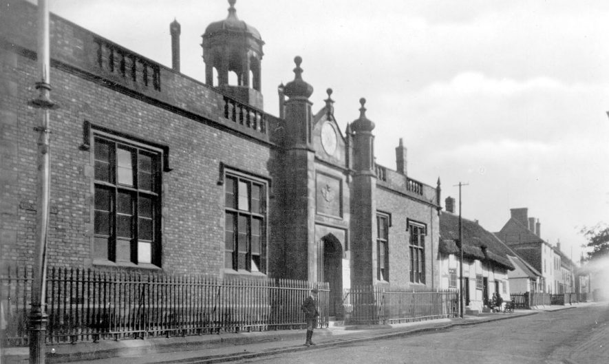 View of Bridge Street, Polesworth with the Nethersole Centre on the left. This building was until the 1970's the village junior school. An inscription over the arch leading to the quadrangle (now hidden from view), tells us that it was