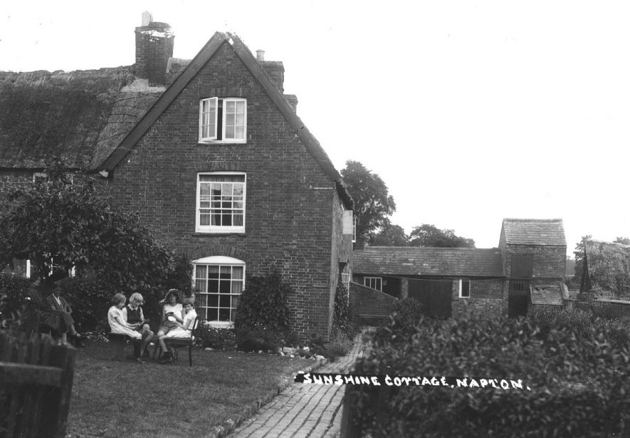 A group of children playing cards outside Sunshine Cottage.  1930s |  IMAGE LOCATION: (Warwickshire County Record Office)