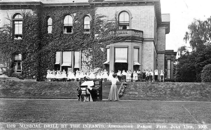 Musical Drill being performed by the infants at Atherstone parish fete on the lawn of a large house in July 1905. |  IMAGE LOCATION: (Warwickshire County Record Office)