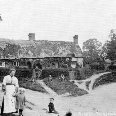 Bishops Tachbrook.  An old cottage and villagers