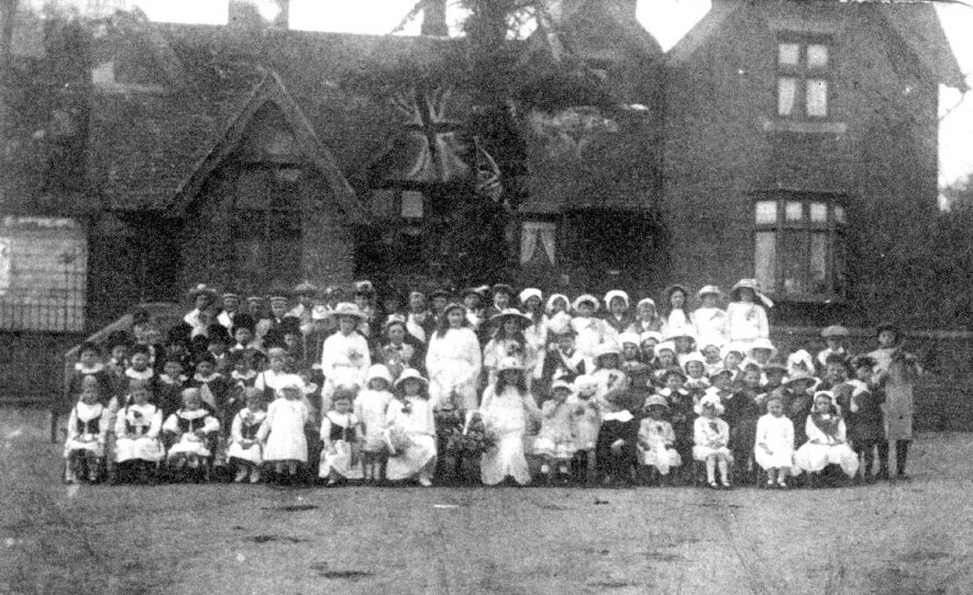 Maypole celebrations in Bishops Tachbrook.  Mrs Johnson is sixth from the left in front row.  1916 |  IMAGE LOCATION: (Warwickshire County Record Office) PEOPLE IN PHOTO: Johnson, Mrs