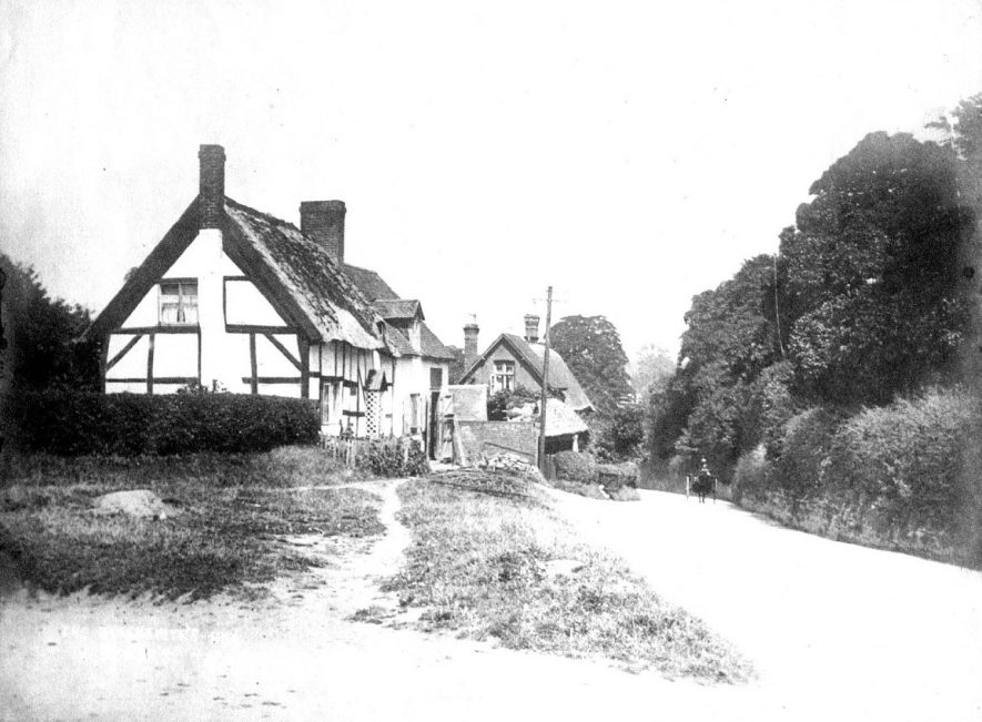 View down Blacksmiths Hill, Bishops Tachbrook.  The car is being driven by Ted Eden, a greengrocer.  1920s    IMAGE LOCATION: (Warwickshire County Record Office) PEOPLE IN PHOTO: Eden, Ted