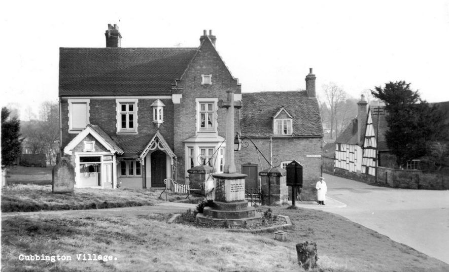 War memorial and part of the graveyard. Village buildings. 1930s |  IMAGE LOCATION: (Warwickshire County Record Office)