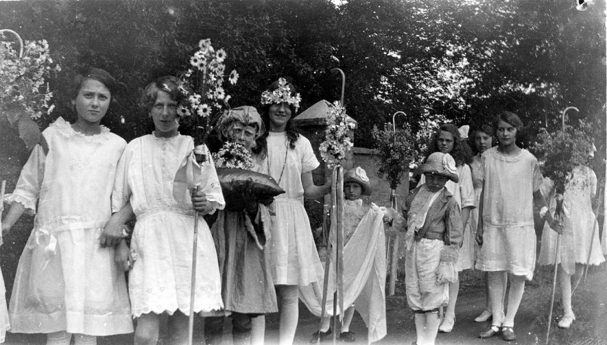 The May Queen about to process from the church to the school playground to be crowned, Cubbington.  1910s
