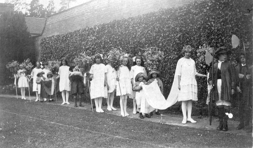 The May Queen's procession about to move off from the vicarage garden to the school playground for the crowning ceremony, Cubbington.  Circa 1910