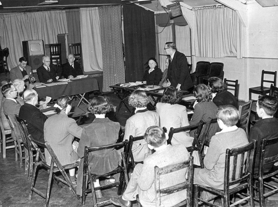 Parish council meeting with senior school pupils sitting in as observers, Cubbington.  1940s