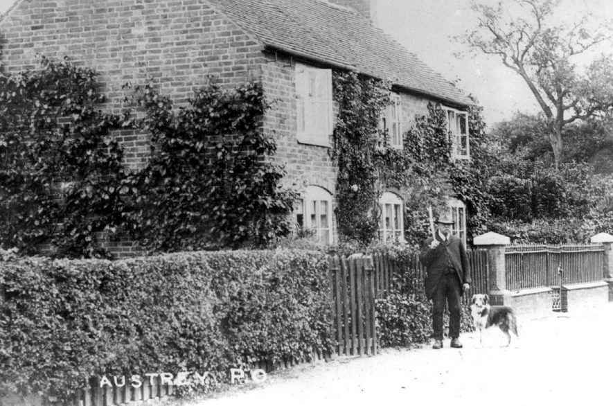 A man and his dog standing outside Austrey Post Office.  1900s |  IMAGE LOCATION: (Warwickshire County Record Office)