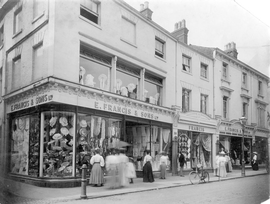 Shop window displays and exterior of E. Francis & Co. Ltd. Bath Street, Leamington Spa.  1920s |  IMAGE LOCATION: (Warwickshire Museums. Photographic Collections.)