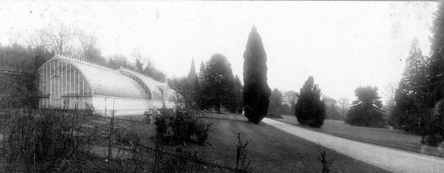 Bitham Hall,  Avon Dassett, showing the gardens and a  greenhouse said to be modelled on the Crystal Palace.  1900s |  IMAGE LOCATION: (Warwickshire County Record Office)