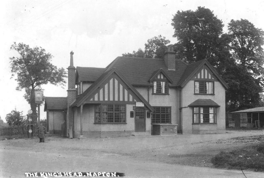 The King's Head, Napton on the Hill.  A view of the front of the public house with a man standing next to a petrol pump (Pratts).  1930s |  IMAGE LOCATION: (Warwickshire County Record Office)