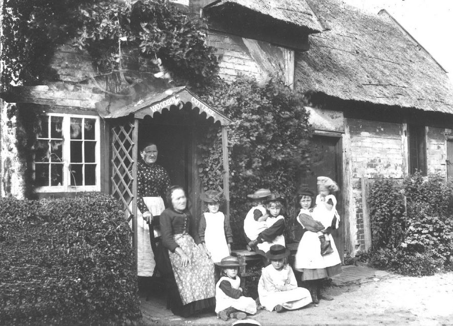 A family outside their cottage in Church Street, Leamington Spa.  1910s |  IMAGE LOCATION: (Warwickshire Museums. Photographic Collections.)