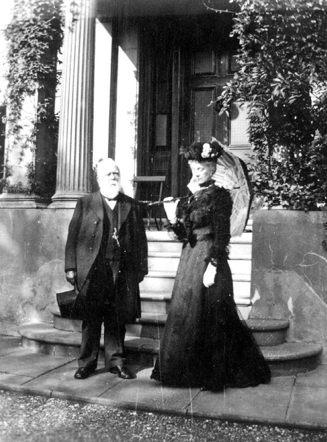 Thomas & Mrs Cooke standing in front of their home, Newbold House, Newbold Terrace, Leamington Spa.  1900s |  IMAGE LOCATION: (Warwickshire Museums. Photographic Collections.) PEOPLE IN PHOTO: Cooke, Thomas, Cooke, Mrs