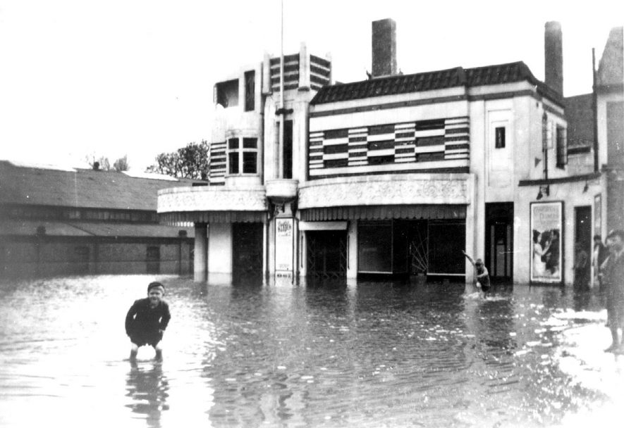 Floods in Portland Place, outside Regal Cinema, Leamington Spa.  1932 |  IMAGE LOCATION: (Warwickshire Museums. Photographic Collections.)