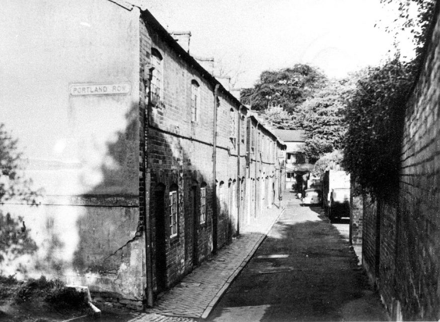 Terraced houses in Portland Row, Leamington Spa.  Copy of photograph lent by Mr. G.F. Hall.  1950s    IMAGE LOCATION: (Warwickshire Museums. Photographic Collections.)