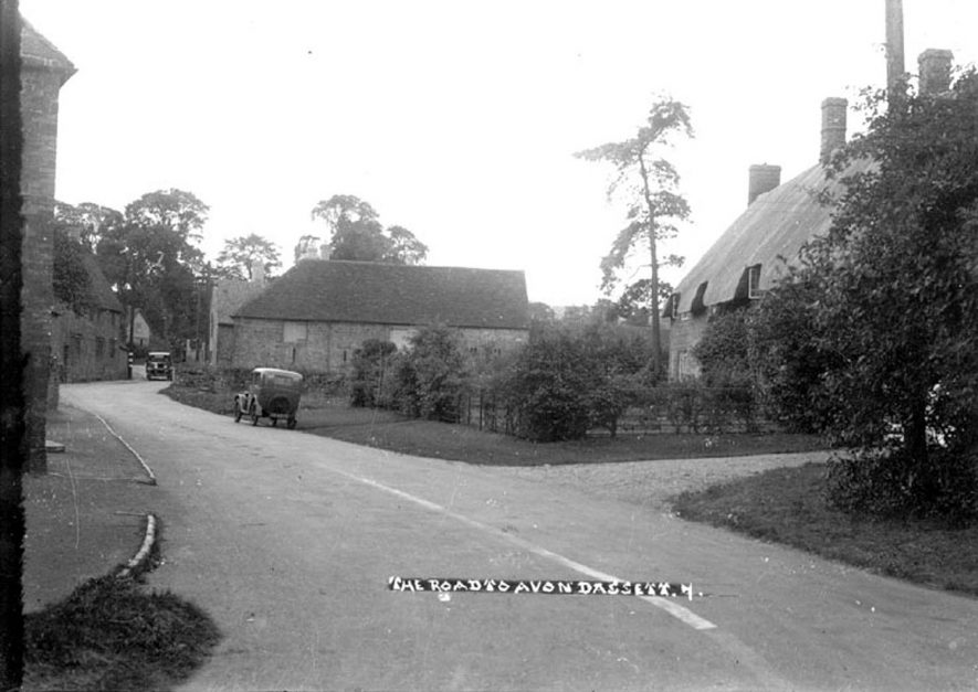 Avon Dassett road, Fenny Compton, showing two parked motor cars.  1930s |  IMAGE LOCATION: (Warwickshire County Record Office)