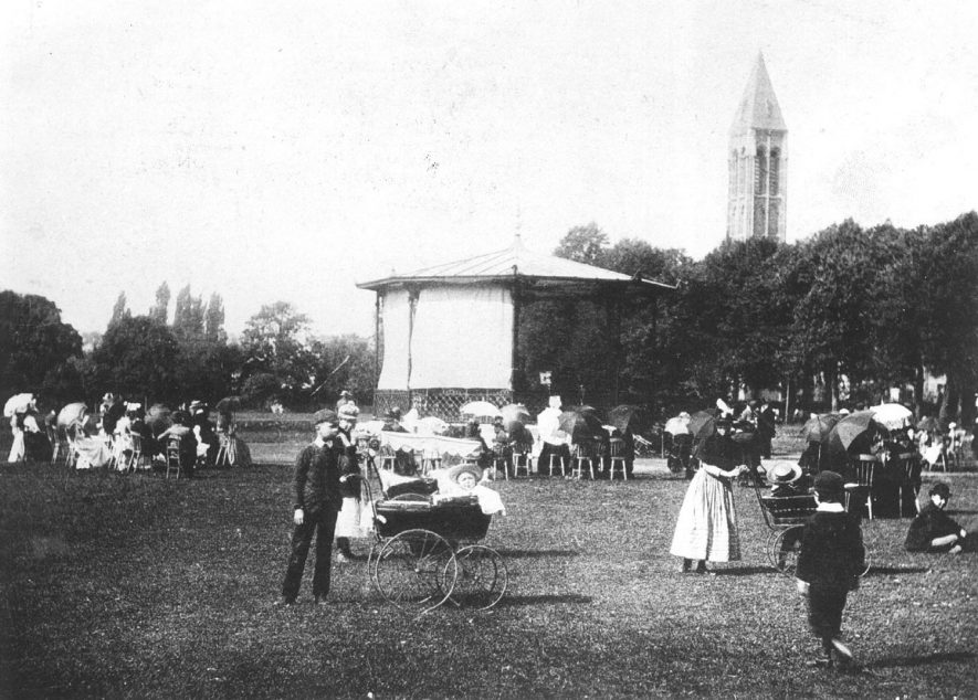 Pump Room Gardens with members of the public walking and seated and two perambulators, Leamington Spa.  1900s |  IMAGE LOCATION: (Warwickshire Museums. Photographic Collections.)