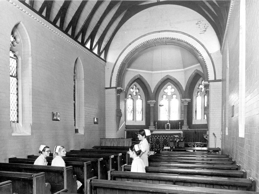 Interior of chapel at the Warneford Hospital with four nurses, Leamington Spa.  1990s |  IMAGE LOCATION: (Warwickshire Museums. Photographic Collections.)