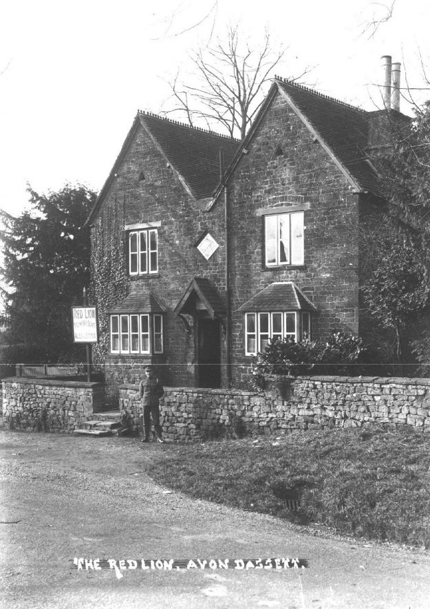 The Red Lion Inn,  Avon Dassett.  Man in military uniform standing at entrance.  1930s |  IMAGE LOCATION: (Warwickshire County Record Office)