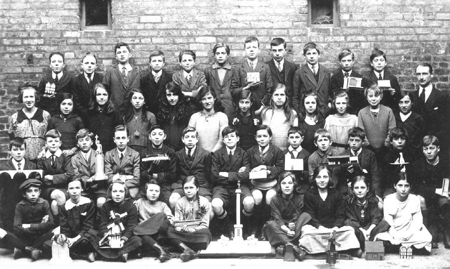 National School Std VII group photograph, showing children holding models, Leamington Spa.  1910s |  IMAGE LOCATION: (Warwickshire Museums. Photographic Collections.)