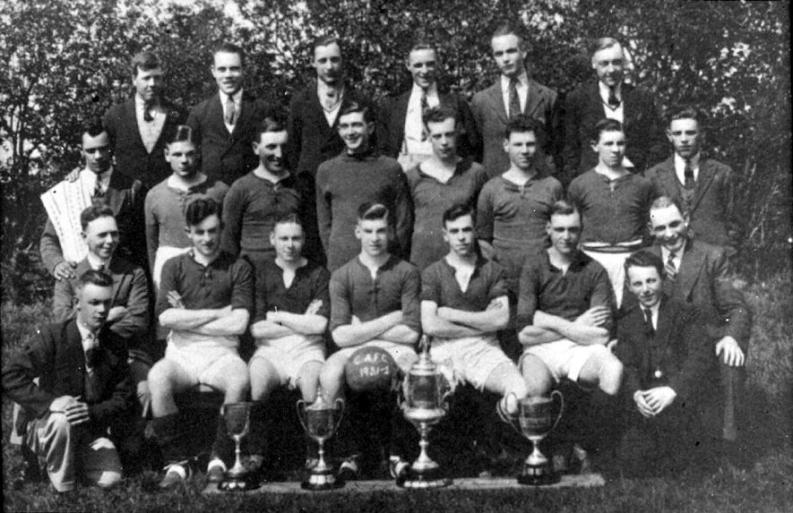 Cubbington football team 1931-32. Back row, left to right - Herbie Skelsey, Arthur Heath, Chris Cleaver, Les Draper, Harry Kensitt, Jim Timms. Middle row - Percy Stone, Harry Goddard, Fred Thompson, Alan Rose, Norman Bass, Bill Hughes, Mr Cleaver, Ernie Hughes. Front row - Vic Eales, George Chamberlain, Jack Smith, Frank Hughes, Ernie Thompson, Mr Bruce, Mr Cleaver and kneeling in front - Walter Kensitt and Harry Eales. |  IMAGE LOCATION: (Warwickshire County Record Office) PEOPLE IN PHOTO: Timms, Jim, Thompson, Fred, Thompson, Ernie, Stone, Percy, Skelsey, Herbie, Rose, Alan, Kensitt, Walter, Kensitt, Harry, Hughes, Frank, Hughes, Ernie, Hughes, Bill, Heath, Arthur, Goddard, Harry, Eales, Vic, Eales, Harry, Draper, Les, Cleaver, Mr, Cleaver, Chris, Chamberlain, George, Bruce, Mr, Bass, Norman