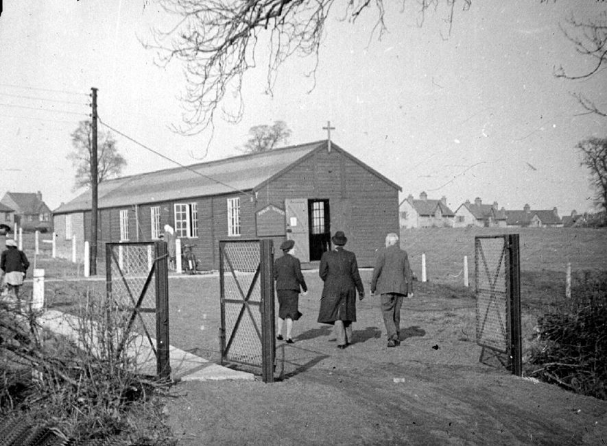 A hut in Cubbington which was used as a temporary Roman Catholic church until 1973. |  IMAGE LOCATION: (Warwickshire County Record Office)