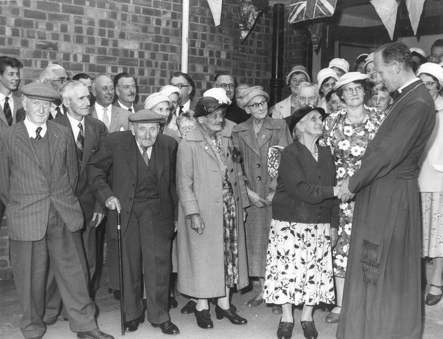 Hunningham school centenary celebrations in 1960. A group of elderly people are seen talking to the Bishop. |  IMAGE LOCATION: (Warwickshire County Record Office)
