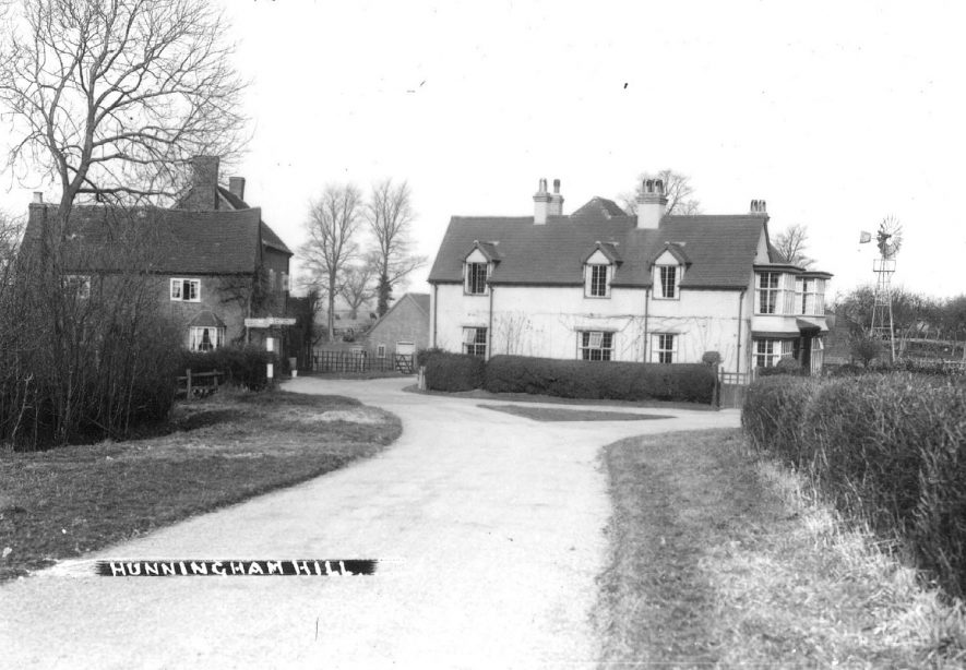 Buildings with a wind powered water pump on the right. Hunningham Hill.  1920s |  IMAGE LOCATION: (Warwickshire County Record Office)