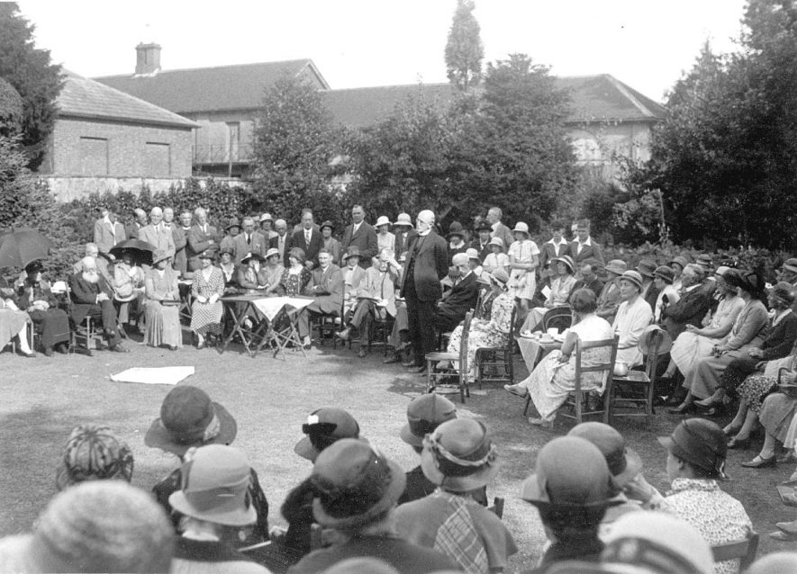 Presentation of a cheque as a farewell gift to the Vicar, Canon Frederick Barre Feist of All Saint's Church in the grounds of Shrubland Hall, Leamington Spa.  He was leaving to become Vicar of Farnborough and Avon Dassett.  1933. The House was demolished around 1939 for building land. |  IMAGE LOCATION: (Warwickshire County Record Office) PEOPLE IN PHOTO: Feist, Revd Frederick Barre