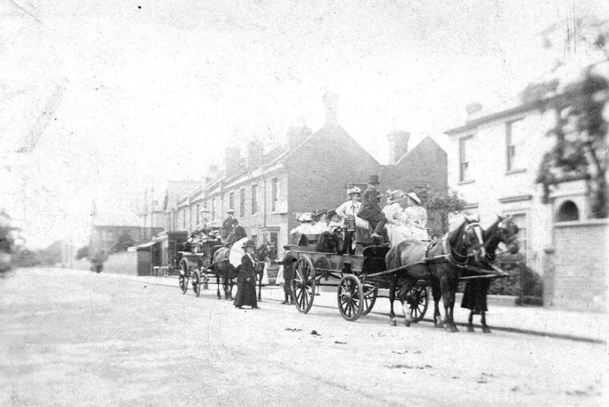 Farley Street, Leamington Spa.  Terraced housing, horses and carriages.  Ladies seated in carriages.  1900s |  IMAGE LOCATION: (Warwickshire County Record Office)