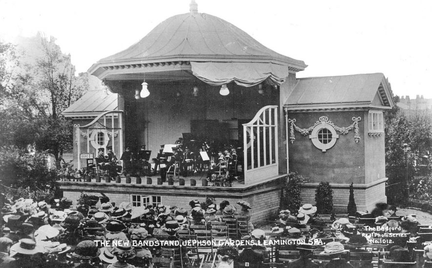 New bandstand in Jephson gardens, Leamington Spa.  Band playing to seated audience.  1900s |  IMAGE LOCATION: (Warwickshire County Record Office)
