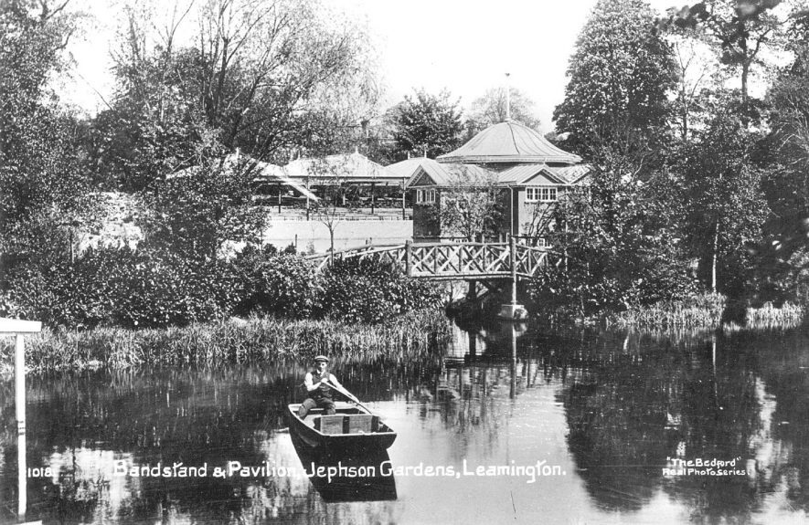 Jephson gardens bandstand & pavilion, Leamington Spa.  Boat, river and wooden bridge.  1900s |  IMAGE LOCATION: (Warwickshire County Record Office)