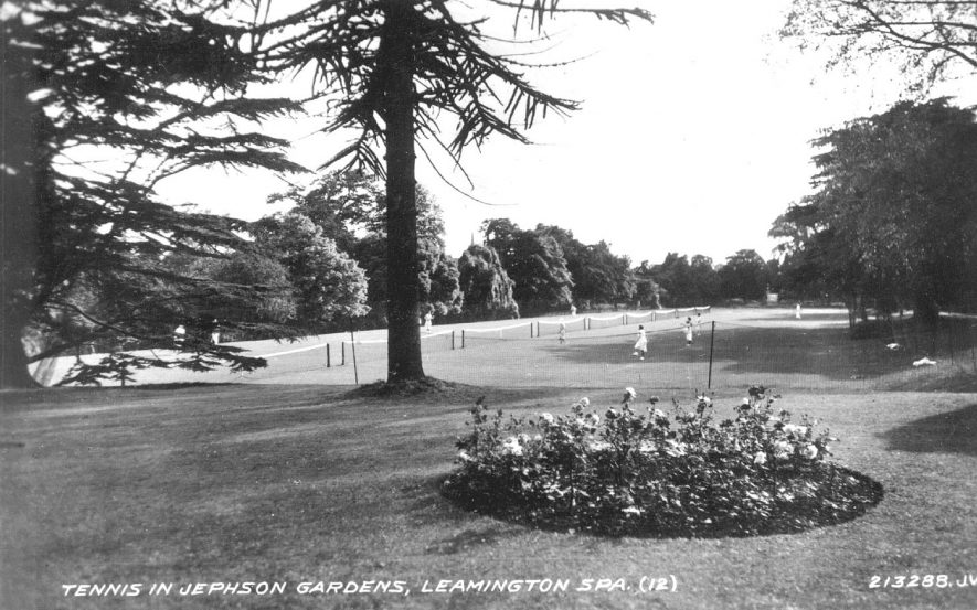Tennis courts and players in Jephson Gardens, Leamington Spa.  1930s    IMAGE LOCATION: (Warwickshire County Record Office)