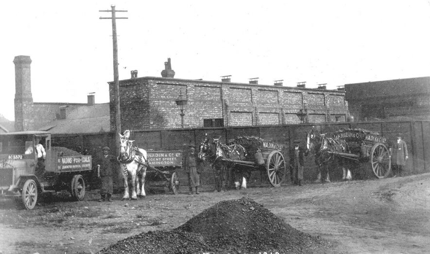 A lorry and three horse and carts belonging to J & N Nadin & Co. coal merchants, making the first delivery to their depot at Milverton station on May 1st 1916. |  IMAGE LOCATION: (Warwickshire County Record Office)