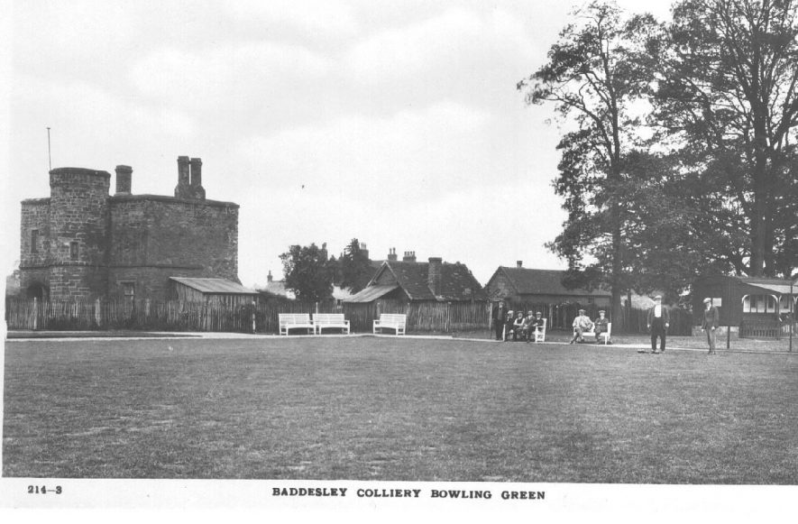 Baddesley Colliery Bowling Green with building , pavilion and men seated on benches.  1920s |  IMAGE LOCATION: (Warwickshire County Record Office)