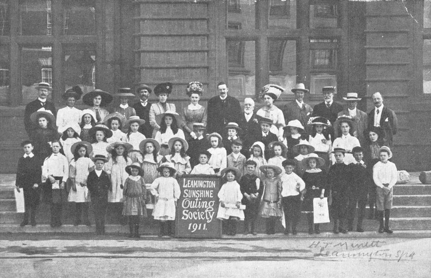 Group photograph of the Leamington Sunshine Outing Society, taken outside the Town Hall.  1911 |  IMAGE LOCATION: (Warwickshire County Record Office)
