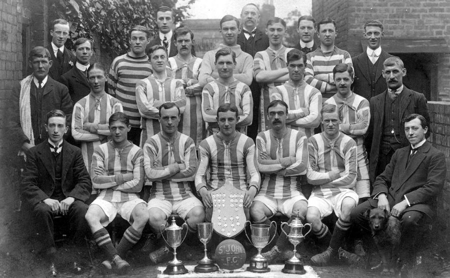 St John's football team photograph on winning a shield, Leamington Spa.  1912/13.  [E W (Ted) Rowlatt was the Captain, seated front centre, holding the shield.] |  IMAGE LOCATION: (Warwickshire County Record Office)