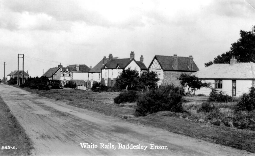 White Rails. Unmade road showing houses on right.  Baddesley Ensor.  1929 |  IMAGE LOCATION: (Warwickshire County Record Office)